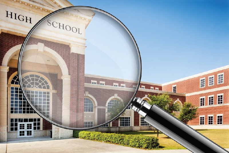 high school through magnifying glass