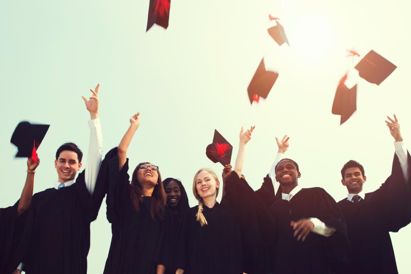 graduation celebration throwing hats
