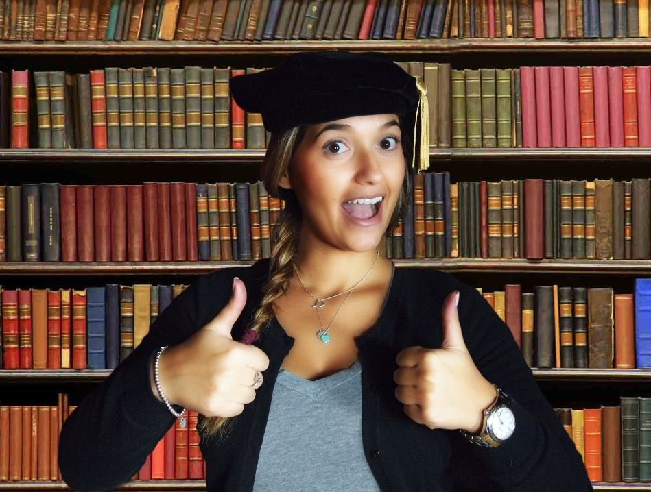 girl thumbs up graduation gown