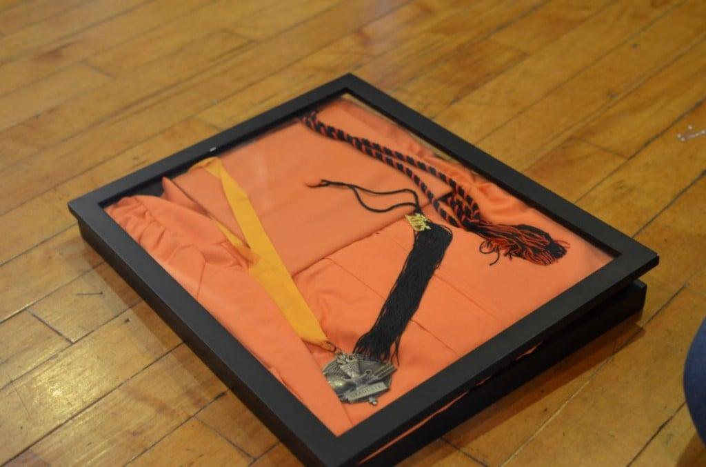 orange graduation gown framed
