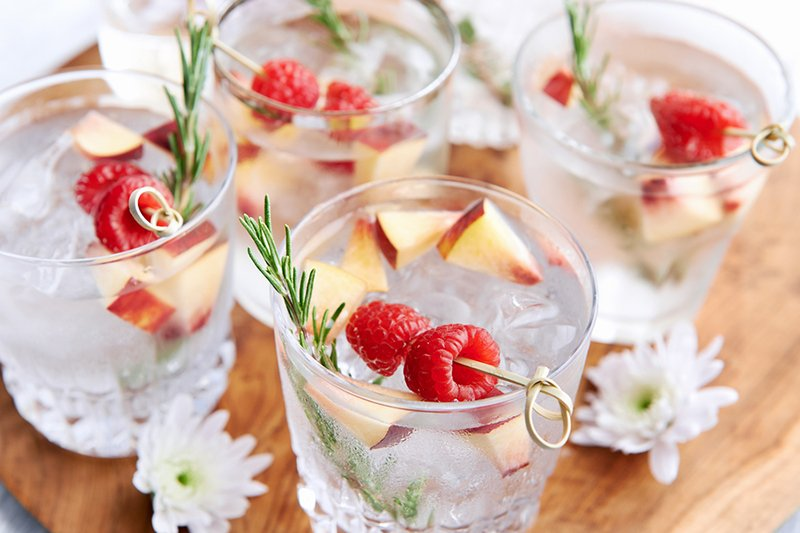 Fruity refreshing mocktails being served on a wooden tray decora