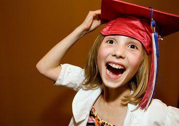 kid wearing red graduation cap