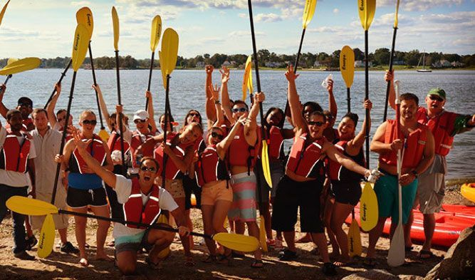 people kayaking celebrating