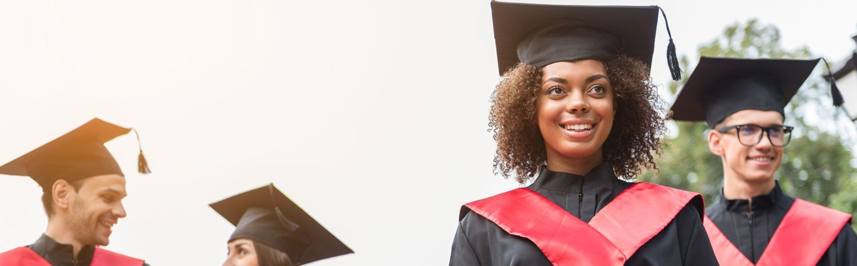 students graduating smiling