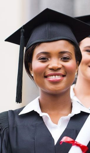 african amercian women with cap gown and diploma